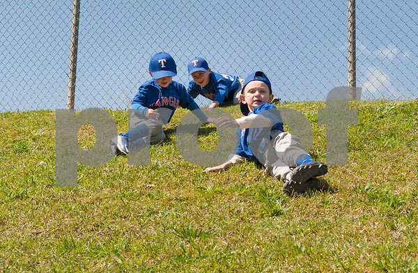Little League baseball players on the Rose Capital East Rangers team play on a hill next to their field after their game Saturday March 19, 2016 at Golden Road Park.  (Sarah A. Miller/Tyler Morning Telegraph)