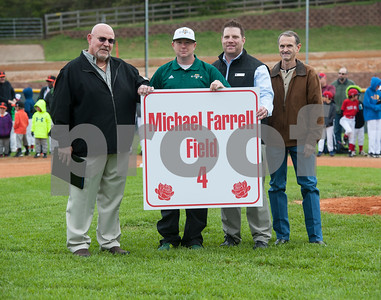 Michael Farrell, far left, is honored with a field renamed in his honor during the Rose Capital West Little League opening ceremony March 19, 2016 at Faulkner Park. Pictured from left: Michael Farrell, Jimmy Boyd, Councilman John Nix and Randy Womble.  (Sarah A. Miller/Tyler Morning Telegraph