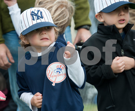 Hayde Morris, 5, shivers during the opening ceremony for Rose Capital West Little League Saturday March 19, 2016 at Faulkner Park. Morris plays on the Yankees T-ball team.  (Sarah A. Miller/Tyler Morning Telegraph