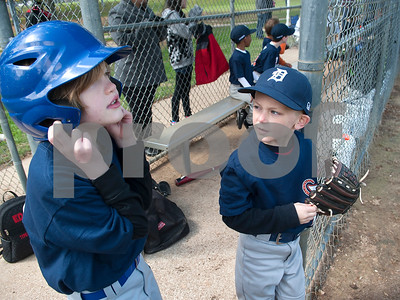 Little League baseball players Nolan Kelly and Parker Dean wait to take the field for their game Saturday March 19, 2016 at Golden Road Park.  (Sarah A. Miller/Tyler Morning Telegraph