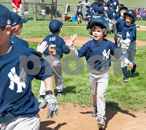 Little League baseball players from the Rose Capital East 5-pitch Tigers team and Yankees team clap hands at the conclusion of their game Saturday March 19, 2016 at Golden Road Park.  (Sarah A. Miller/Tyler Morning Telegraph
