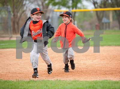 Jude Litner and Alex Graham play tag before the start of their first game of the season with the Rose Capital West Little League Giants T-ball Saturday March 19, 2016 at Faulkner Park.   (Sarah A. Miller/Tyler Morning Telegraph