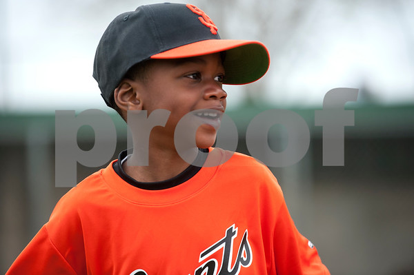 Reid Herron, 5, smiles as he waits for his first game to begin with the Rose Capital West Little League Giants T-ball Saturday March 19, 2016 at Faulkner Park.   (Sarah A. Miller/Tyler Morning Telegraph