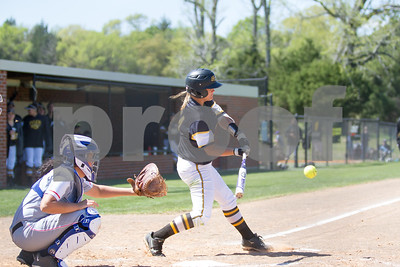TJC's Karli Herron hits a double in game 1 against Angelina College. Photo by John Murphy