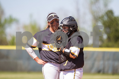 Abby Walker and Jo Rivera have a discussion on the mond during game 1 against Angelina College. TJC went on to win game 1 3 to 2.  Photo by John Murphy