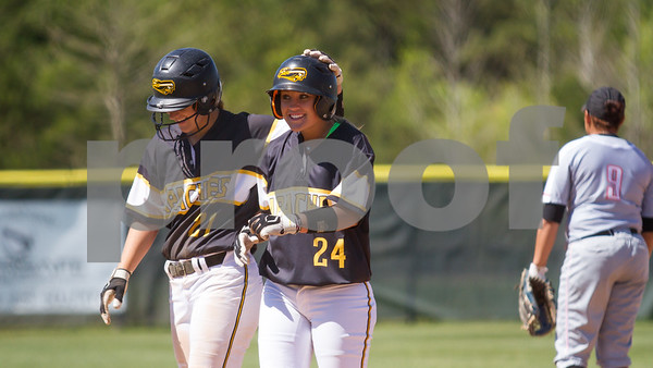 Amber Landry (21) and Karli Herron (24)  share a moment durning a pitching change in Game 1  against Angelina College.  TJC went on to win 3 to 2. Photo by John Murphy