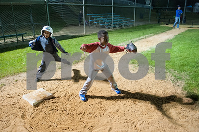 Kayden Carey, 6, of Tyler, waits for the ball at first base as hitter Jayvin Hewitt, 5, of Tyler, runs to the base during T-ball practice with the Rose Capital East Bluejays at Golden Road Park in Tyler Wednesday March 2, 2016. The coed team is made up of children ages 3, 4, and 5. The team's first game will be held opening day Saturday March 19.   (Sarah A. Miller/Tyler Morning Telegraph)