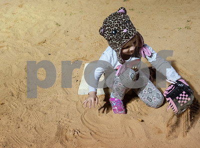 Sophia Pratt, 4, of Whitehouse, plays in the sand at third base during T-ball practice with the Rose Capital East Bluejays at Golden Road Park in Tyler Wednesday March 2, 2016. The coed team is made up of children ages 3, 4, and 5. The team's first game will be held opening day Saturday March 19.   (Sarah A. Miller/Tyler Morning Telegraph)
