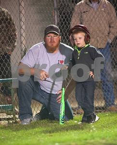 Dayson Carey of Arp stays close to his son Jackson Carey, 4,  during his first day of  T-ball practice with the Rose Capital East Bluejays at Golden Road Park in Tyler Wednesday March 2, 2016. The coed team is made up of children ages 3, 4, and 5. The team's first game will be held opening day Saturday March 19.   (Sarah A. Miller/Tyler Morning Telegraph)