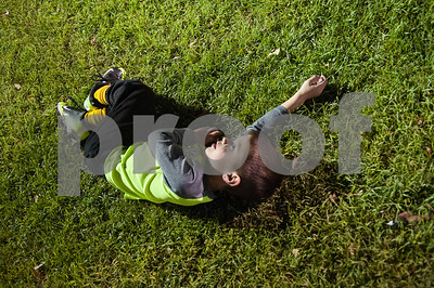 Sam Reed, 5, of Whitehouse, takes a brief nap on the field at the conclusion of T-ball practice for the Rose Capital East Bluejays at Golden Road Park in Tyler Wednesday March 2, 2016. The coed team is made up of children ages 3, 4, and 5. The team's first game will be held opening day Saturday March 19.   (Sarah A. Miller/Tyler Morning Telegraph)