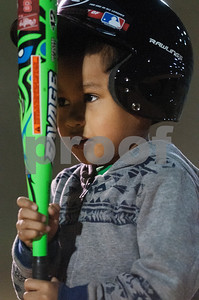 Alex Tran, 4, of Tyler, bounces his bat off the lip of his helmet as he waits to hit during T-ball practice for the Rose Capital East Bluejays at Golden Road Park in Tyler Wednesday March 2, 2016. The coed team is made up of children ages 3, 4, and 5. The team's first game will be held opening day Saturday March 19.   (Sarah A. Miller/Tyler Morning Telegraph)