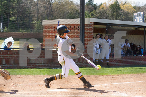 TJC's Karli Herron advances runners with this base hit.  TJC went on to defeat Northeast Texas CC 10 to 1 in the open game of Region XIV play in Bullard TX.  photo by John Murphy