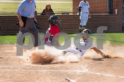 Jazlyn Crowder slides safely under the tag of Sydney Hurley.  TJC went on to defeat Northeast Teaxas CC 10 to 1.  Photo by John Murphy
