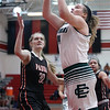 Elyria Catholic's Ally Winnen shoots in the lane past Sarah Rapecz of Padua during the first quarter. Randy Meyers -- The Morning Journal