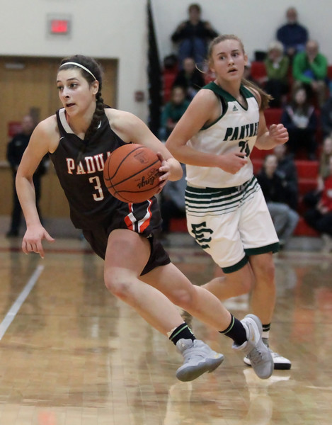 Padua guard Elena Rauhe pushes the ball up the floor as Sam Filiaggi of Elyria Catholic trails on the play during the third quarter. Randy Meyers -- The Morning Journal