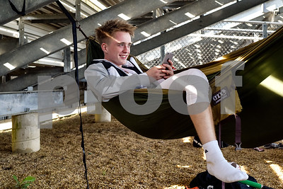 Chandler Bass relaxes in a hammock during a track and field meet at Van High School in Van, Texas, on Thursday, March 22, 2018. (Chelsea Purgahn/Tyler Morning Telegraph)