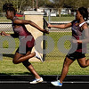 Track athletes compete during a track and field meet at Van High School in Van, Texas, on Thursday, March 22, 2018. (Chelsea Purgahn/Tyler Morning Telegraph)