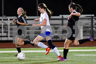 Chapell Hill's Keely Walters (8) kicks the ball during a class 4A bi-district game at Robert E. Lee High School in Tyler, Texas, on Thursday, March 23, 2017. (Chelsea Purgahn/Tyler Morning Telegraph)