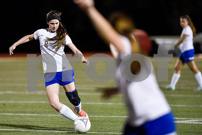 Chapel Hill's Keely Walters (8) kicks the ball during a class 4A bi-district game at Robert E. Lee High School in Tyler, Texas, on Thursday, March 23, 2017. (Chelsea Purgahn/Tyler Morning Telegraph)