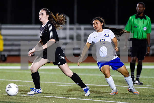 Spring Hill's Avery Barnhill (15) kicks the ball during a class 4A bi-district game at Robert E. Lee High School in Tyler, Texas, on Thursday, March 23, 2017. (Chelsea Purgahn/Tyler Morning Telegraph)