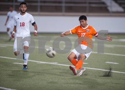 Mineola's (17) Jr. Palacios kicks the ball away as Kilgore's (18) Elian Torres approaches Thursday night at Christus Trinity Mother Frances Rose Stadium in Tyler.  (Sarah A. Miller/Tyler Morning Telegraph)