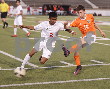 Mineola's (14) Liberio Perez kicks the ball from Kilgore's (2) Brandon Espinoza Thursday night at Christus Trinity Mother Frances Rose Stadium in Tyler.  (Sarah A. Miller/Tyler Morning Telegraph)