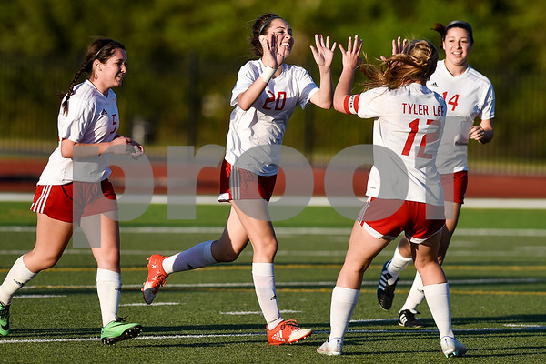 Robert E. Lee sophomore Maddie Bice (20) celebrates her goal with teammates during a class 6A bi-district game at Robert E. Lee High School in Tyler, Texas, on Thursday, March 23, 2017. (Chelsea Purgahn/Tyler Morning Telegraph)