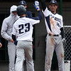 Lorain's Jeff Santana is congratulated at the dugout by teammate Manny Brown after scoring a run against Brookside. Randy Meyers -- The Morning Journal