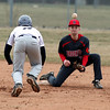 Brookside shortstop Christian Fields watches the throw coming towards him during a steal attempt at second base by Tre'von Morgan of Lorain. Randy Meyers -- The Morning Journal