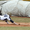 Lorain's Blake Bartlome dives back to first safely as Brookside's first baseman Travis Fortney can't make a back-handed stop. Randy Meyers -- The Morning Journal