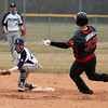 Lorain's Blake Bartlome covers second base and will make the tag on Travis Fortney of Brookside for the out. Randy Meyers -- The Morning Journal