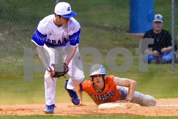 A Grace player bends to catch the ball as a Brook Hill player slides into third base during a high school baseball game at Grace Community School in Tyler, Texas, on Monday, March 26, 2018. (Chelsea Purgahn/Tyler Morning Telegraph)