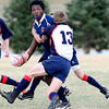 Boulder Lion Shaquelle Chambers (left), Silver Creek, is tackled by James Kreitman (right), Silver Creek during rugby practice at Valmont City Park in Boulder, Colorado March 26, 2012. CAMERA/MARK LEFFINGWELL