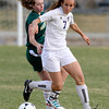 Holy Family's Abby Dunkle (right) steals the ball from Machenbuef's Cate Hegarty (left) during their soccer game at Holy Family High  in Broomfield, Colorado March 27, 2012. CAMERA/MARK LEFFINGWELL