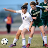 Holy Family's Taylor Johnson (left) and Machenbuef's Rosie Sabin (right) for the ball during their soccer game at Holy Family High  in Broomfield, Colorado March 27, 2012. CAMERA/MARK LEFFINGWELL