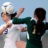 Holy Family's Domonique Giron (left) heads the ball away from Machenbuef's Molly Tynan (right) during their soccer game at Holy Family High  in Broomfield, Colorado March 27, 2012. CAMERA/MARK LEFFINGWELL