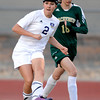 Holy Family's Taylor Johnson (left) passes the ball away from Machenbuef's Myranda Weakland (right) during their soccer game at Holy Family High  in Broomfield, Colorado March 27, 2012. CAMERA/MARK LEFFINGWELL