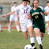 Holy Family's Monica Stokes (left) bumps Machenbuef's Keara O'Toole (R) during their soccer game at Holy Family High  in Broomfield, Colorado March 27, 2012. CAMERA/MARK LEFFINGWELL