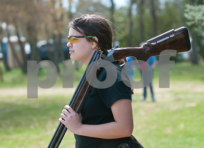 photo by Sarah A. Miller/Tyler Morning Telegraph  Seventh-grader Bre Cantrell, 13, of the Grace Community School Cougar Shotgun Team watches her teammates shoot in the Youth Target Foundation East Regional Competition Friday March 27, 2015 at Rose City Flying Clays in Tyler.