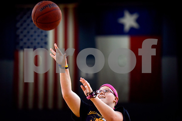 Brittany Lamb shoots the ball during the Special Olympics at UT Tyler in Tyler, Texas, on Monday, March 27, 2017. Nearly 40 special olympians played basketball, soccer, track and field, volleyball and ping pong with over 100 UT Tyler athletes. (Chelsea Purgahn/Tyler Morning Telegraph)
