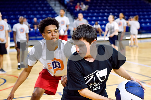Skyler Hadden guards Cole Whitaker as they play basketball during the Special Olympics at UT Tyler in Tyler, Texas, on Monday, March 27, 2017. Nearly 40 special olympians played basketball, soccer, track and field, volleyball and ping pong with over 100 UT Tyler athletes. (Chelsea Purgahn/Tyler Morning Telegraph)
