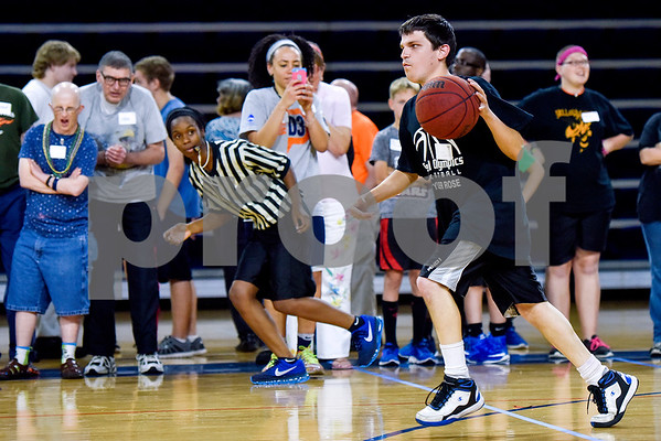 Cole Whitaker dribbles the ball down the court during the Special Olympics at UT Tyler in Tyler, Texas, on Monday, March 27, 2017. Nearly 40 special olympians played basketball, soccer, track and field, volleyball and ping pong with over 100 UT Tyler athletes. (Chelsea Purgahn/Tyler Morning Telegraph)
