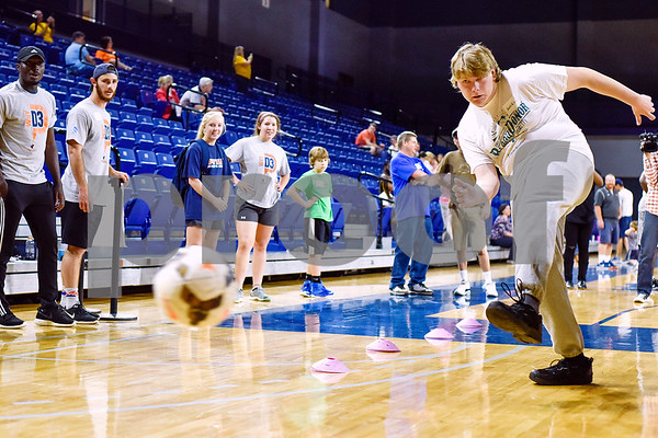 Justen Wright kicks a soccer ball during the Special Olympics at UT Tyler in Tyler, Texas, on Monday, March 27, 2017. Nearly 40 special olympians played basketball, soccer, track and field, volleyball and ping pong with over 100 UT Tyler athletes. (Chelsea Purgahn/Tyler Morning Telegraph)