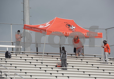 Mineral sets up their team tent during the Class 3A Region II meet at Wildcat Stadium in Whitehouse Friday April 28, 2017.  (Sarah A. Miller/Tyler Morning Telegraph)