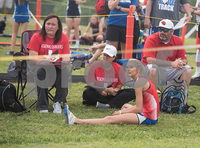 Sydney Gerbine of Sabine High School sits with her coaches after her second attempt at the triple jump at the Class 3A Region II meet at Wildcat Stadium in Whitehouse Friday April 28, 2017.  (Sarah A. Miller/Tyler Morning Telegraph)