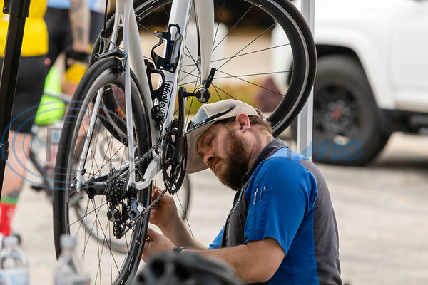 Joshua with Cycology Bike Co. gives a bike a quick adjustment before the 32nd Beauty and the Beast Bike Tour. photo by John Murphy, Focus In On Me