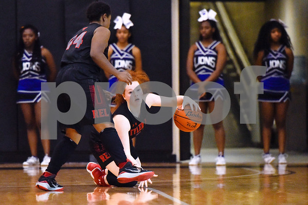 Robert E. Lee sophomore guard Hannah Haynes (22) falls as she tries to regain control of the ball during a high school basketball game at Tyler Junior College in Tyler, Texas, on Friday, Jan. 12, 2018. (Chelsea Purgahn/Tyler Morning Telegraph)