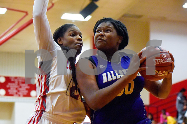 Hallsville senior Katoria Jakson (50) jumps to shoot the ball as Robert E. Lee sophomore Aaliyah Morgan (21) attempts to block her during a high school basketball game at Robert E. Lee High School in Tyler, Texas, on Tuesday, Nov. 14, 2017. (Chelsea Purgahn/Tyler Morning Telegraph)