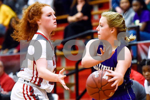 Robert E. Lee sophomore Hannah Haynes (22) blocks Hallsville freshman Abby Dunagan (4) during a high school basketball game at Robert E. Lee High School in Tyler, Texas, on Tuesday, Nov. 14, 2017. (Chelsea Purgahn/Tyler Morning Telegraph)