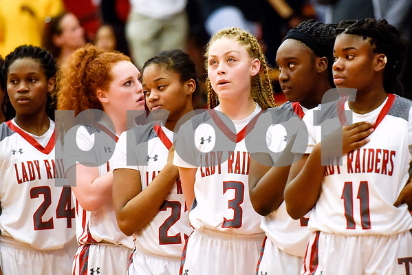 Robert E. Lee players stand during the national anthem at a high school basketball game at Robert E. Lee High School in Tyler, Texas, on Tuesday, Nov. 14, 2017. (Chelsea Purgahn/Tyler Morning Telegraph)